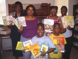 Savvy Members Donating Books to The John Perkins Foundation