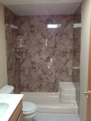 After: Seated Shower, Walls Madeira Granite & header removed for spaciousness.