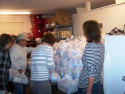 3-19-13 Volunteers stack newly-packed totes