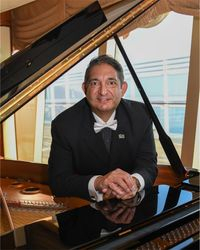 2017 on board Queen Elizabeth cruise ship (as a passenger) but playing daily requests for invited friends