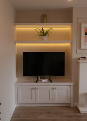 Alcove cabinet with floating shelves and intergrated lights with dimming function