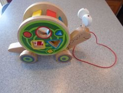Hape Walk-A-Long Snail Toddler Wooden Pull Toy - $17