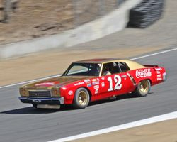 Race winning 1971 Chevy Monte Carlo exits the Corkscrew