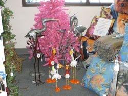 Birds flocking around pink Christmas Tree