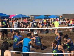 Dirty Deeds Peace Love Mud Volleyball