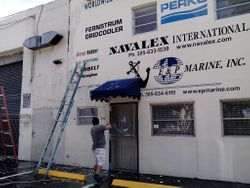 Pressure cleaning the Wall Before the Hand Painted Signage is Applied