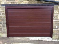 Wooden sectional door.