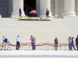 View of Casket Guarded by Clerks and Crowd of Mourners at West Façade of US Supreme Court Building from West-Northwest During Lying in Repose of Associate Supreme Court Justice Ruth Bader Ginsburg