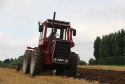 MF1200 ploughing