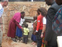 After the unveiling, the plaque was removed and children placed copies of the Project Report, Lutheran Catechism and a Global Volunteers logo behind the plaque
