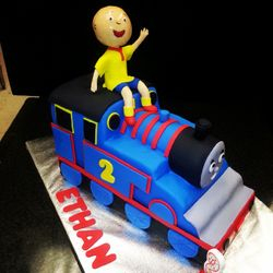 Caillou on top of Train Cake