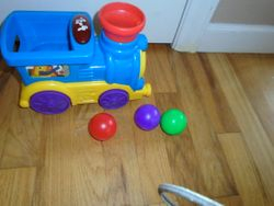 Bright Starts Roll & Pop Train Toy Ball Popper Musical Activity Toy - $10