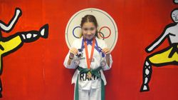04/03/2011 Championship Ana Marie Gomez  1st place forms 2nd place breaking 2nd place fighting