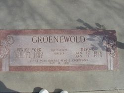 "42"" pink granite grass marker set in concrete"