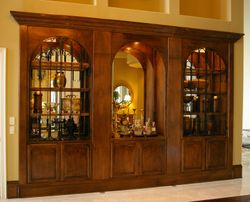 Custom Built-In With Iron Doors, Mirror Backing