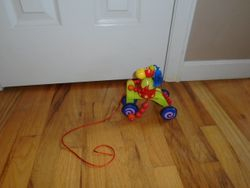 Janod Wooden Pull Along Toy Monkey Riding Tricycle - $10