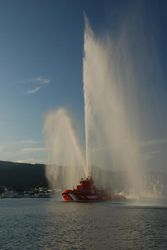 The Pobra festival - the rescue boat spraying water in the air