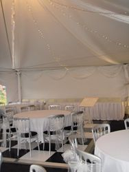 Simple white drapes and leds in a hexagon marquee