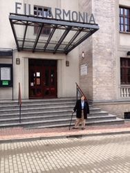 VC standing by the Zabrze Philharmonic's hall, the morning after her concert 1