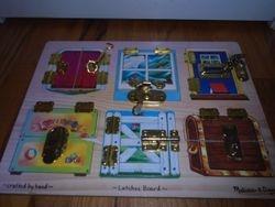 Melissa & Doug Deluxe Latches Board - $14