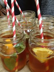 Pimms in Jam Jars with vintage paper straws