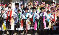 Young girls from children and teenage dance groups of Greek Diaspora Estia ROUMLOUKIOTON in Alexadria walking on thraditional costumes and singing the carols of L Resurrecion Saturday, Easter 2016, destined for I.M.N. Assumption