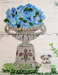Hydrangea blooms in an antique urn