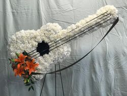 Guitar Spray of white Carnations