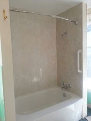 After New Travertine Surround, Grab Bar, New Tub Liner!