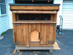 small chicken coop with large front window open