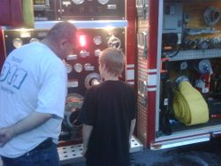 Captain Curtis assisting Junior FF Duvall