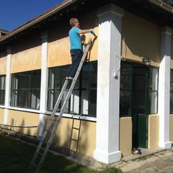 Lindsay painting the clinic
