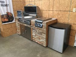 Built in grill w/ fridge, burners, drawers & doors