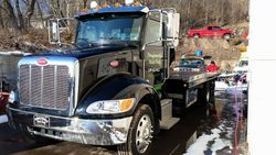2015 Peterbilt 330 Century S-12 LCG Steel Bed