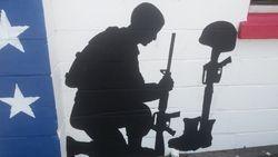 The kneeling solider.