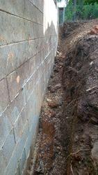 Exposing Retainwall for waterproofing & new ag line