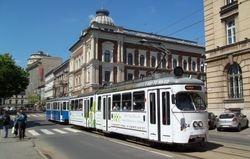 E1 tram & trailer heading East, along Basztowa