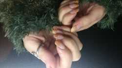 Acryl met oranje-gouden glitter french