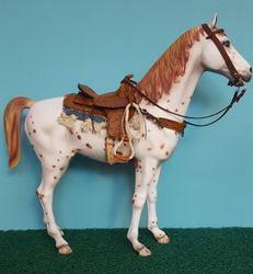 Sergio L. horse wearing a saddle by me