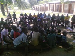 Chiefs having meeting and organising distribution of donated items