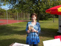Laura Beth holds her third book.