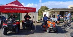 Andy's & Malcolm checking out Peter Glidden Honda ride ons