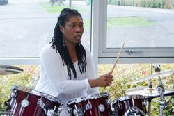 S Foster playing the drums during one of the church service on Sunday