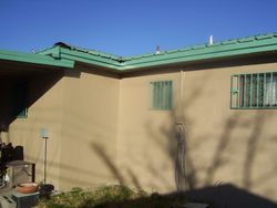 Metal Roof, Stucco, Facia, Soffit, and Paint