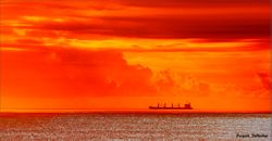 Cargo ship at sunrise off Marina Beach