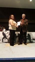 Conrad presents BTC coaching certificate to Tina