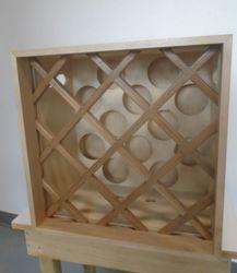 "12 bottle wine rack: 16""wide x 12""deep x 18""high  $70.00"