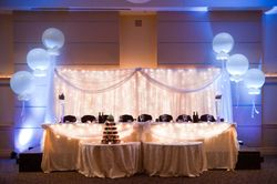 Head Table Decor - pipe and drape outlined with 3 foot balloons