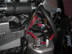 Roll-over valve installed between the MCX tee and the oil tank
