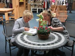 Carol Klein signing her books for me